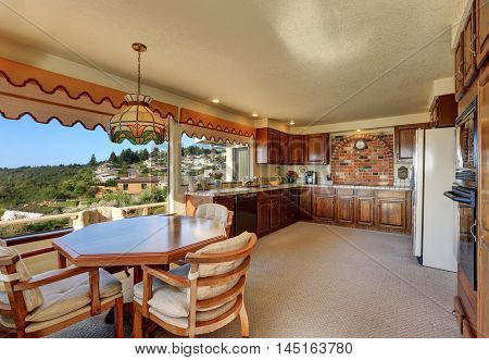 Kitchen And Dining Room Interior With Carpet Flooring
