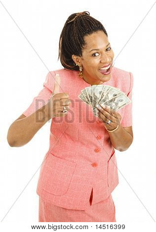 Beautiful young woman holding cash and giving a thumbsup.  Isolated on white.