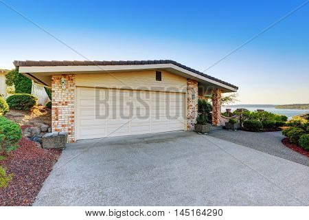 House Exterior. Garage With Concrete Driveway