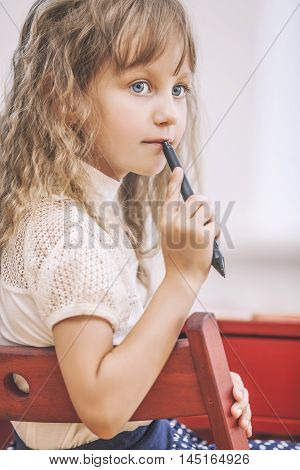 Girl writes a letter to the desire in the school