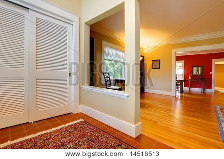 Nice Large Open Hallway And Living Room With Red Wall