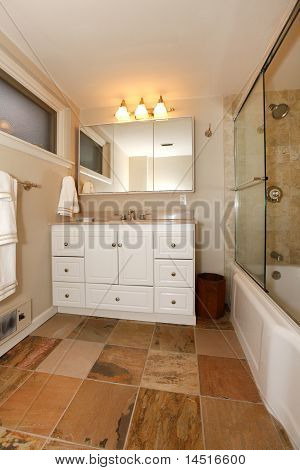 Luxury Classic Basement Bathroom With White And Beige