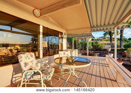Luxury House Exterior. Back Deck With Sunset Reflection In Windows
