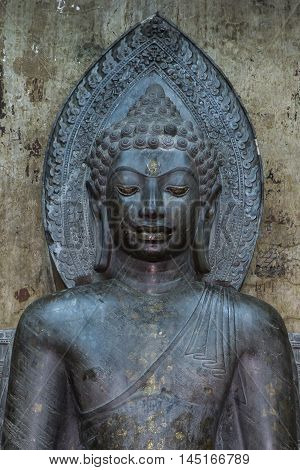 Buddhist sacred beliefs . Close up Stone Buddha About a thousand years old in Thailand.