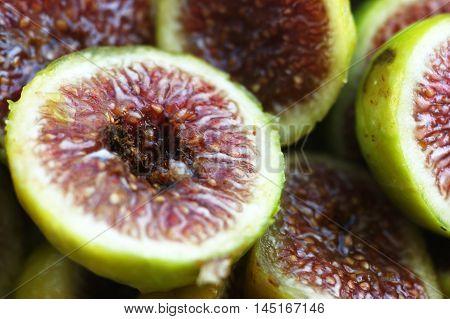 Half of ripe sliced figs close up