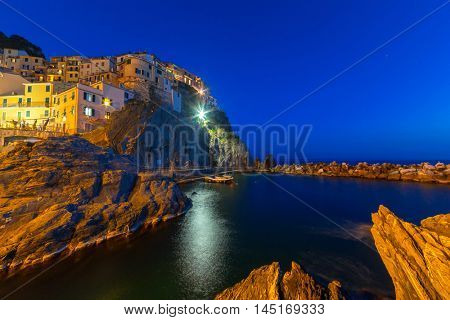 Manarola town on the coast of Ligurian Sea at night, Italy