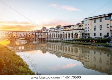 Cityscape view on Arno riverside with Canottiery arch building and famous bridge on the sunset in Florence