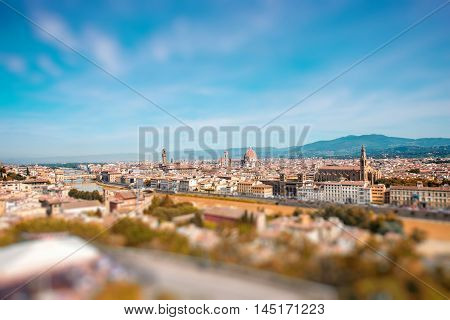 Florence aerial cityscape view from Michelangelo square on the old town with famous cathedral church and river in Italy. General plan with copy space, tilt-shift effect