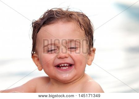 Funny baby cooling off in the pool