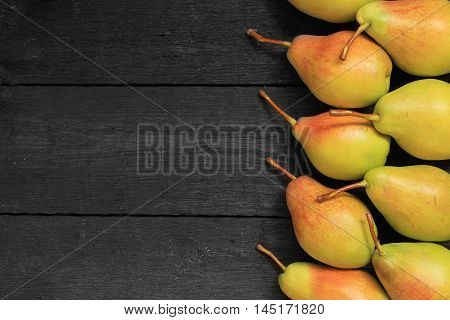 Close up view of ripe pears. View with fresh pears. Ripe pears background. Free place for text.Top view