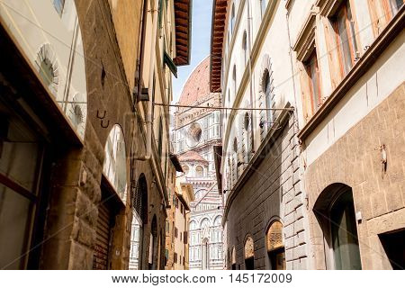 Florence street view with dome of Santa Maria del Fiore church in Italy