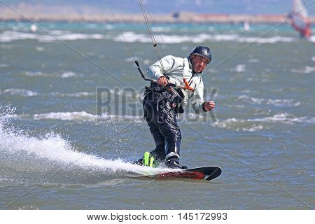 kitesurfer riding his board in Portland harbor