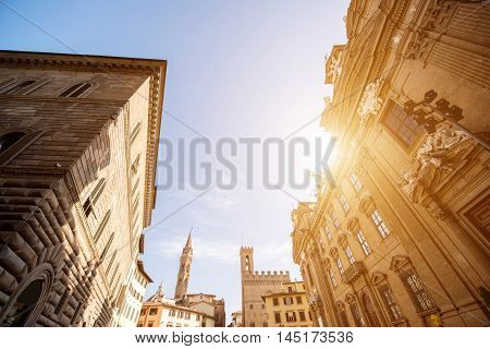Florence cityscape view with Badia Fiorentina church tower and San Firenze complex on the sunset in Italy
