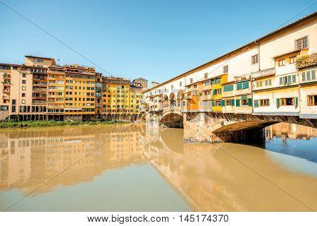 Cityscape view on famous Ponte Vecchio bridge on Arno river in Florence