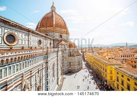 Top cityscape view on the dome of Santa Maria del Fiore church and old town in Florence