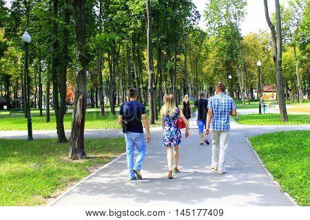 Kharkiv / Ukraine. 07 August 2016: people having a rest in the city park with big trees. 07 August 2016 in Kharkiv / Ukraine.