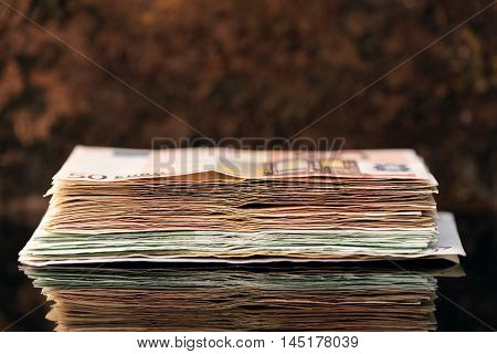 Euro Stack banknotes of fifties and hundrets concept pension and capital