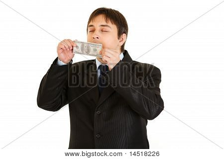 Modern businessman delightfully sniffing hundred dollar banknote isolated on white