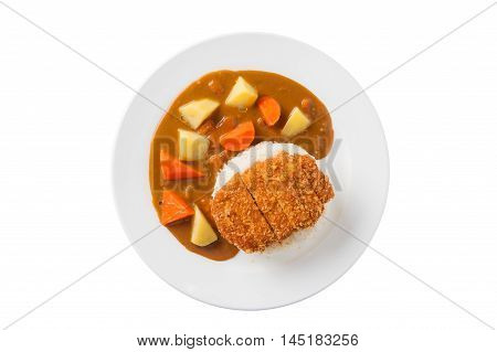 Top view of Japanese cuisine rice with deep fried pork and curry sauce with potatoes and carrots in ceramic dish isolated on white background