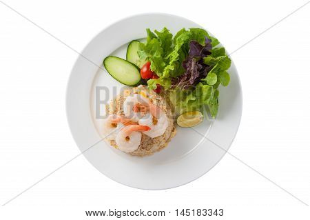 Top view of Thai style cuisine fried rice with shrimp garnished with vegetables in ceramic dish isolated on white background