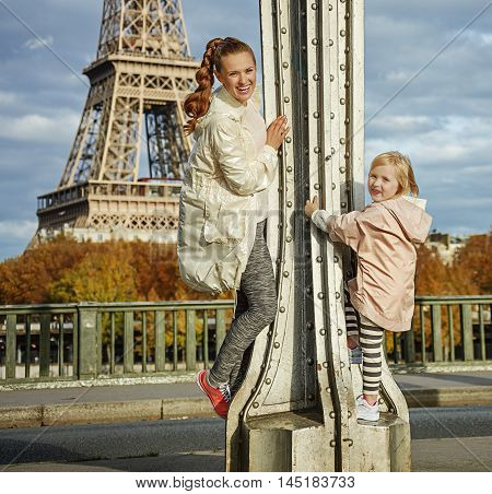 Healthy Mother And Daughter Having Fun Time In Paris
