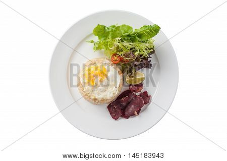 Top view of Modern Thai style fried rice with salted beef and fried egg in ceramic dish isolated on white background