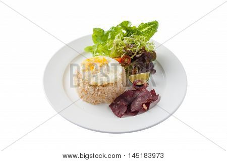 Front view of Modern Thai style fried rice with salted beef and fried egg in ceramic dish isolated on white background