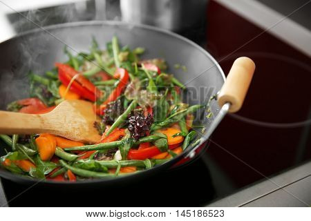 Mixing vegetables in pan closeup