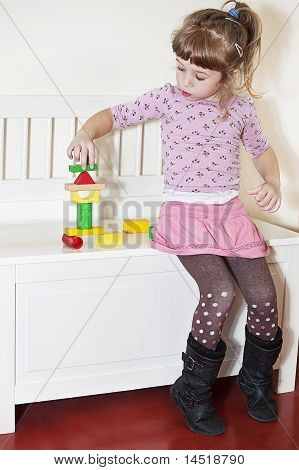 Girl And Wooden Blocks
