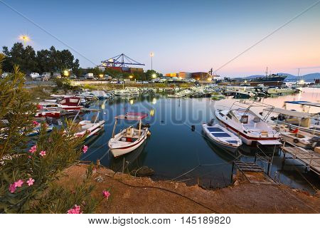 ATHENS, GREECE - AUGUST 31, 2016: Small harbour with fishing boats and motor boats between terminal 3 of the container port and shipyards of Perama on August 31, 2016.