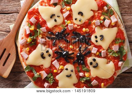 Pizza For Halloween With Ham, Cheese And Olives Close-up. Horizontal Top View