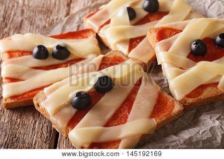 Halloween Sandwiches With Cheese, Ketchup And Olives Close-up. Horizontal