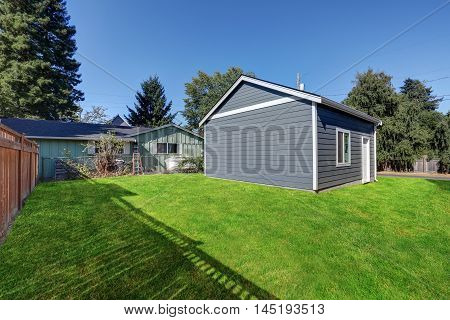 Grass Filled Back Yard With Detached Garage