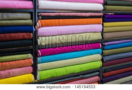 Roll in a colorful satin fabric store. Satin with a satin patterned on the popular Chinese garment.