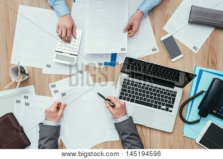 Business People Checking Tax Forms