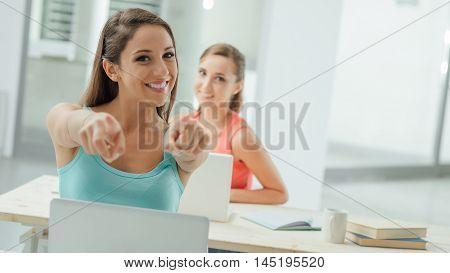 Cheerful Student Pointing At Camera