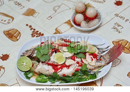 Tilapia fish streamed lemon on Selective focus.
