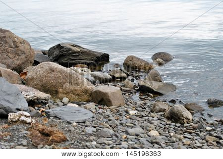 A Rocky Shore with Very Still Water