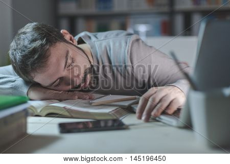 Sleepy Young Man At Desk