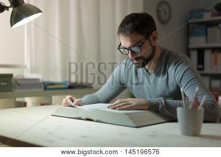 Smart Man Studying At Night
