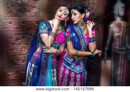 Two beautiful harem girls or belly dancers or Hindu brides