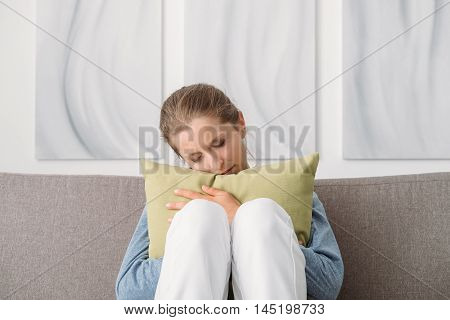 Sad Woman Hugging A Pillow