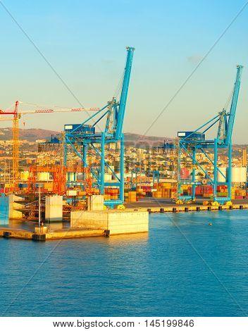 View of industrial port at sunet. Civitavecchia Italy