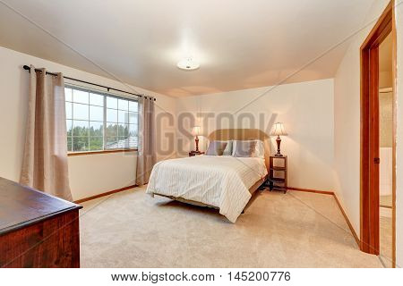 Simple Beige Bedroom With Minimal Interior Design