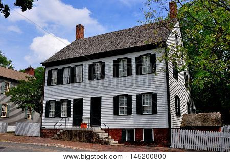 Old Salem North Carolina - April 21 2016: 1815-1854 wood frame two story John Plum House on Main Street with double doors and staircases *