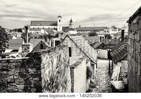 Old houses streets and churches in Skalica town Slovak republic. Travel destination. Black and white photo. Architectural theme.