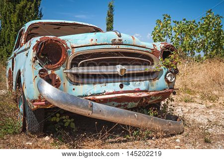 Old Abandoned Rusted Car, Closeup Photo