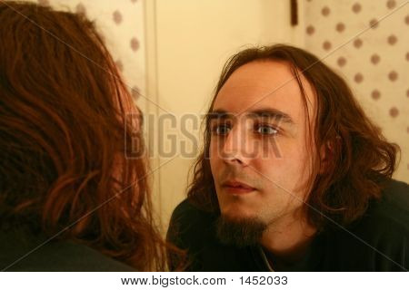 Man Looking At Himself On Mirror