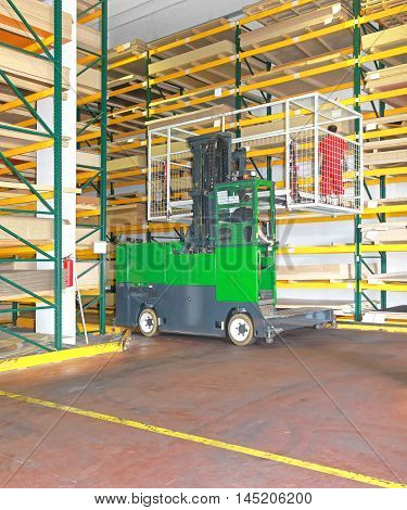 Side Loaded Forklift With Basket in Timber Warehouse