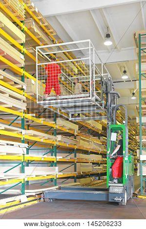 Workers Handling Wood Board in Side Loader Forklift